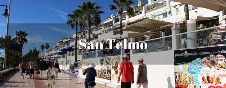 """Recht tegenover het strand Las Vistas en naast de haven """"Los Cristianos"""", biedt de San Telmo Mall driehonderdvijfenzestig dagen per jaar recreatie, handel en amusement. Dit winkelcentrum heeft veel verschillende activiteiten, zoals: auto huren,iets drinken,parfum,Kaartjes voor de belangrijkste attracties van het eiland,... Het is elke dag geopend, maar op zondag van 9.00 uur tot 18.00 uur"""